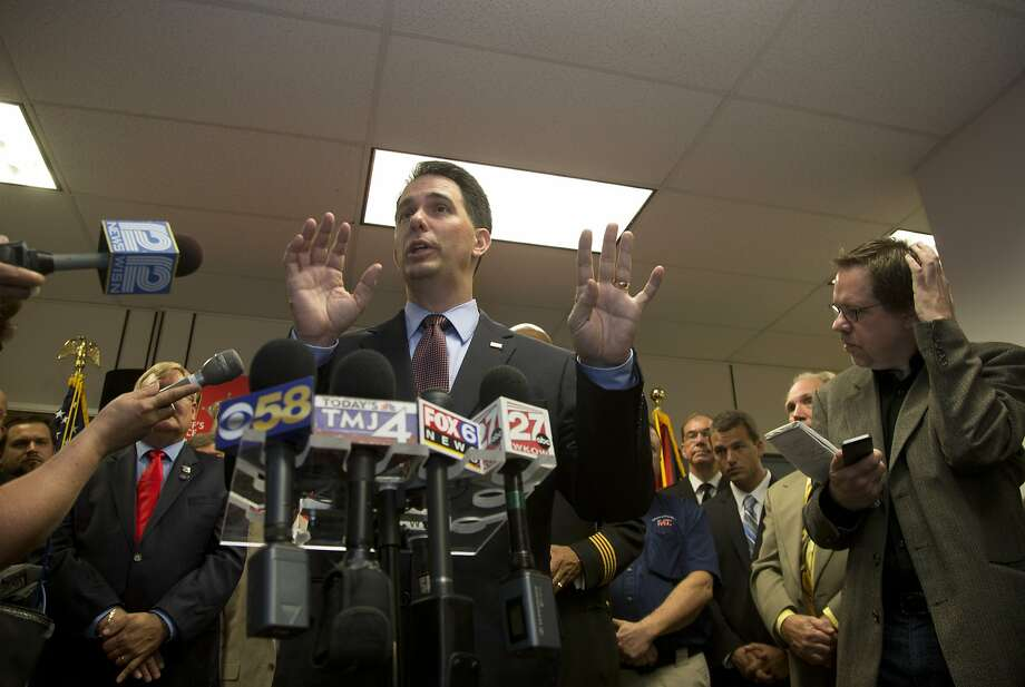 Wisconsin Governor Scott Walker speaks after signing a bill at the Milwaukee County Sheriff's office that eliminates a 48-hour waiting period for handgun purchases. Wednesday, June. 24,  2015, in Milwaukee.  (AP Photo/Jeffrey Phelps) Photo: Jeffrey Phelps, Associated Press