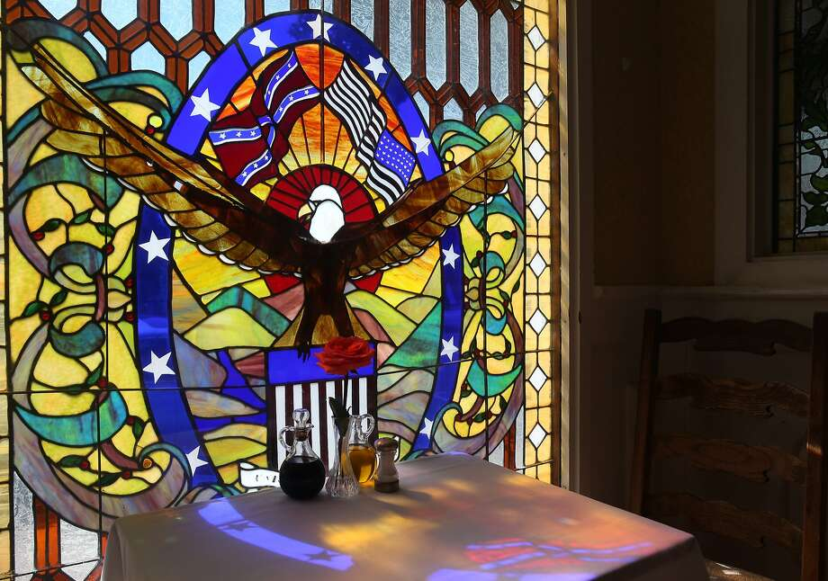 A stained glass panel in the restaurant at the historic Union Hotel bears a Confederate flag flying above a bald eagle in Benicia, Calif. on Wednesday, June 24, 2015. The flag has sparked a national debate after last week's church shooting in South Carolina. Photo: Paul Chinn, The Chronicle