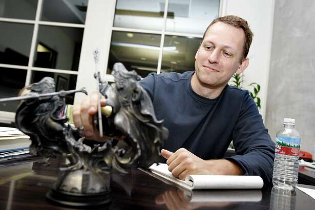 FOUNDERFUND_038_RAD.jpg SHOWN:   Peter Thiel, one of the founding partners of The Founders Fund, in his office with a cool Lord of the Rings sculpture.   These photos were made on Monday, Dec. 11, 2006, in San Francisco, CA. (Katy Raddatz/SF Chronicle) * Peter Thiel Ran on: 12-13-2006 Ken Howery (left), Peter Thiel (middle) and Sean Parker (right) of The Founders Fund are all veterans of high-profile startups. Ran on: 12-13-2006 Ken Howery (left), Peter Thiel (middle) and Sean Parker (right) of The Founders Fund are all veterans of high-profile startups. Ran on: 12-13-2006  Ran on: 09-07-2007 Fears of malevolent thinking robots propel the plots of movies such as &quo;I, Robot.&quo; Ran on: 09-07-2007 Fears of malevolent thinking robots propel the plots of movies such as &quo;I, Robot.&quo;