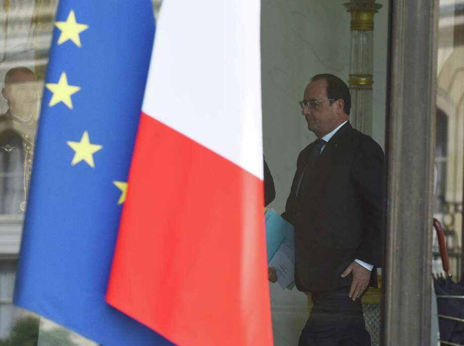 French President Francois Hollande walks through the lobby of the Elysee Palace after the weekly cabinet, Wednesday, June 24, 2015 in Paris, France. France summoned the U.S. ambassador to the Foreign Ministry on Wednesday following revelations by WikiLeaks that the U.S. National Security Agency eavesdropped on the past three French presidents. (AP Photo/Kamil Zihnioglu) Photo: Kamil Zihnioglu, STR / AP