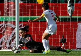 EDMONTON, AB - JUNE 20:  Goalkeeper Wang Fei #12 of China PR saves a shot on goal against Cameroon during the FIFA Women's World Canada 2015 Round of 16 match between China PR and Cameroon at Commonwealth Stadium on June 20, 2015 in Edmonton, Canada.  (Photo by Kevin C. Cox/Getty Images)