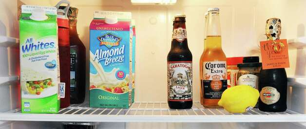 Items in Time Warner Cable News anchor Kate Welshofer's refrigerator Thursday June 18, 2015 in Albany, NY.   (John Carl D'Annibale / Times Union) Photo: John Carl D'Annibale / 00032319A