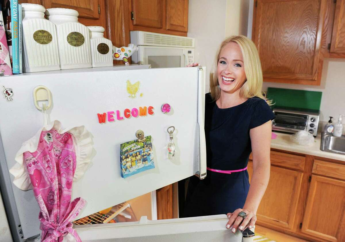 Time Warner Cable News anchor Kate Welshofer at the refrigerator in her kitchen Thursday June 18, 2015 in Albany, NY. (John Carl D'Annibale / Times Union)