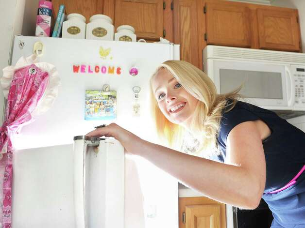 Time Warner Cable News anchor Kate Welshofer at the refrigerator in her kitchen Thursday June 18, 2015 in Albany, NY.   (John Carl D'Annibale / Times Union) Photo: John Carl D'Annibale / 00032319A