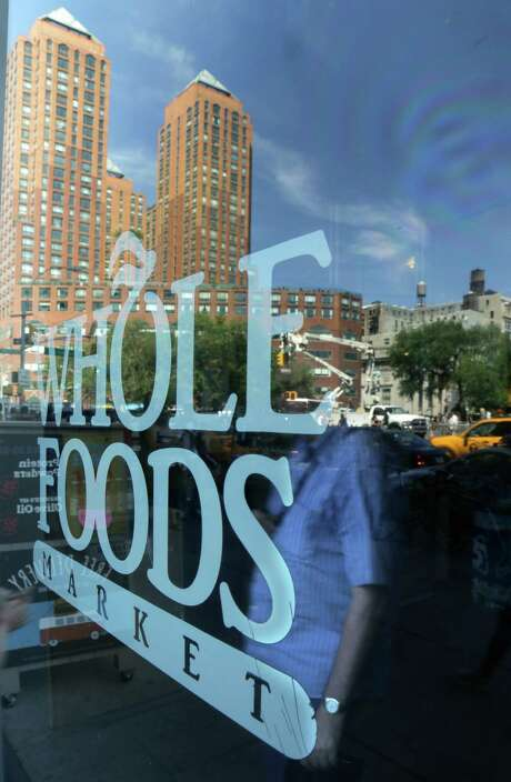 Shoppers visit a Whole Foods in New York. The chain has been accused of overstating the weight of prepackaged items. Photo: Julie Jacobson, STF / AP