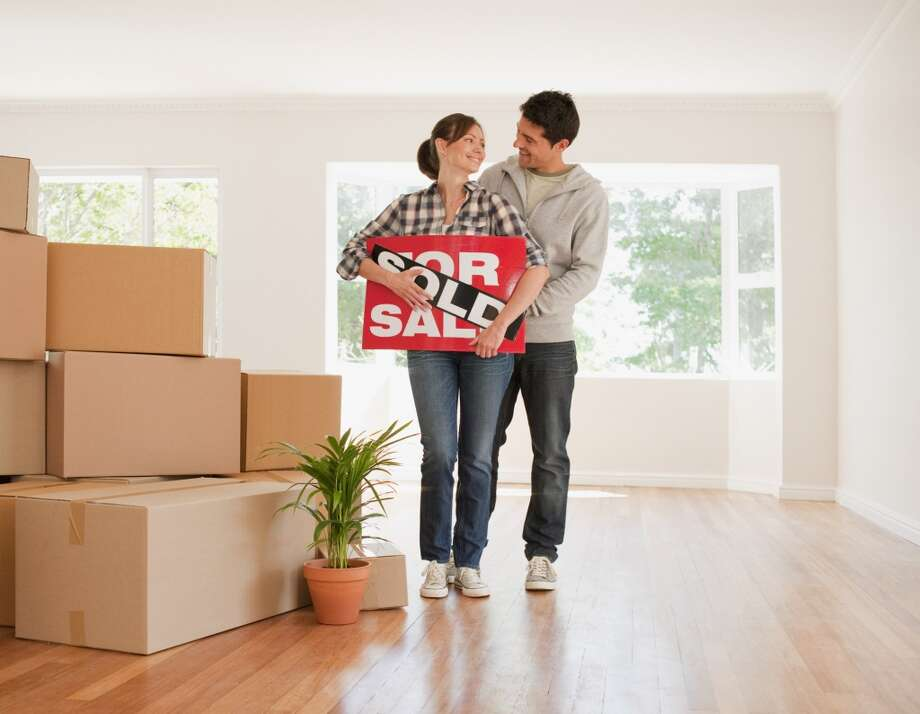 It's time for millennials to buy in Houston, according to real estate website Trulia. Photo: Martin Barraud, Getty Images/OJO Images RF