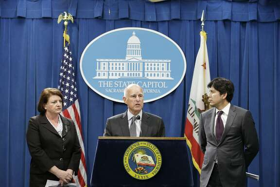 In this photo taken June 16, 2015, Calif., Gov. Jerry Brown, center, discusses the compromise budget he reached with Assembly Speaker Toni Atkins, D-San Diego, left, and Senate President Pro Tem Kevin de Leon, D-Los Angeles, at a Capitol news conference, in Sacramento, Calif.,  Brown signed the $115.4 billion budget plan Wednesday, June 24, 2015, that takes effect in the new fiscal year starting next month. (AP Photo/Rich Pedroncelli)