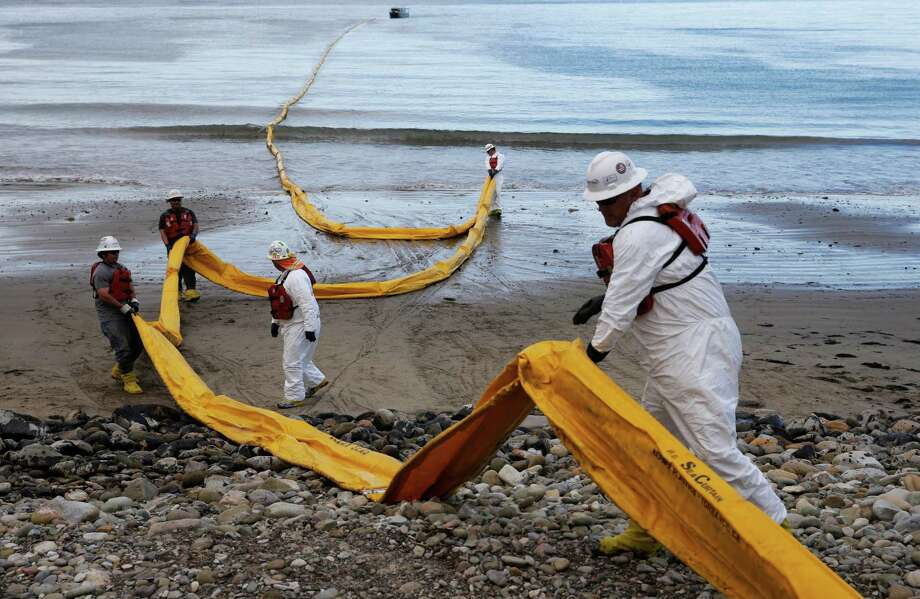 Workers last month prepare an oil containment boom at Refugio State Beach, north of Goleta, Calif. Plains All American Pipeline says it has spent $96 million responding to the accident. Photo: Jae C. Hong, STF / AP