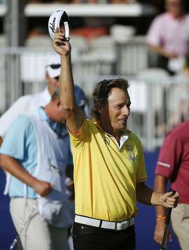Bernhard Langer, of Germany, facts after finishing on the 18th green during the final round of the Senior Players Championship golf tournament in Belmont, Mass., Sunday, June 14, 2015. Langer won with 19-under par. (AP Photo/Michael Dwyer)