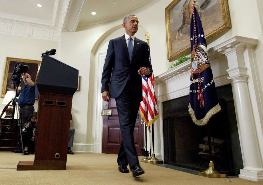 President Barack Obama walk from the podium after speaking in the Roosevelt Room of the White House in Washington, Wednesday, June 24, 2015, about the completion of the Hostage Policy Review. The president is clearing the way for families of U.S. hostages to pay ransom to terror groups without fear of prosecution, as the White House seeks to address criticism from those whose loved ones have been killed in captivity. (AP Photo/Carolyn Kaster) Photo: Carolyn Kaster, STF / Associated Press / AP