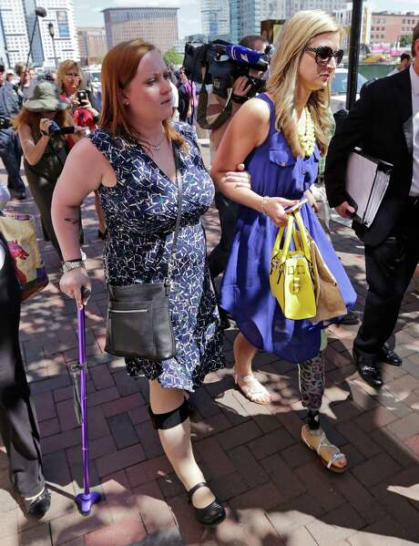 Boston Marathon bombing survivors Erika Brannock, left, and Rebekah Gregory DiMartino leave the Moakley Federal Courthouse clutching each other following the formal sentencing of Dzhokhar Tsarnaev in Boston on Wednesday.  Tsarnaev apologized to the victims and their loved ones for the first time Wednesday just before the judge formally sentenced him to death. (AP Photo/Charles Krupa) Photo: Charles Krupa, STF / AP