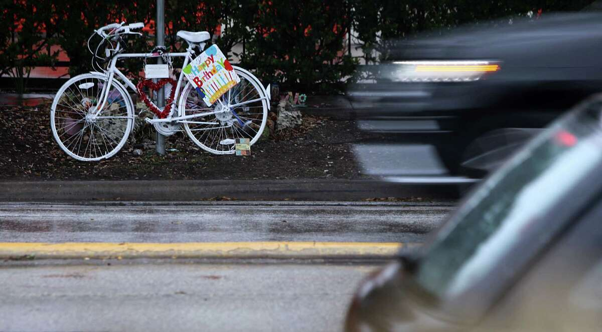 A ghost bike stands near the location where a bicyclist lost her life in Houston.