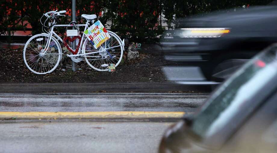 A ghost bike stands near the location where a bicyclist lost her life in Houston. Photo: Mayra Beltran, Staff / Â 2013 Houston Chronicle