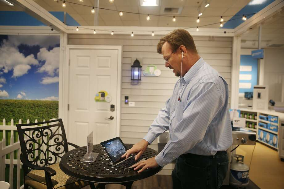 Mitchell Lee, Sears experience center manager, views the display from a doorbell camera synchronized with a mobile device as he works  in the Outdoor vignette display at the Sears Connected Solutions flagship store at The Shops at Tanforan on Wednesday, June 24, 2015 in San Bruno, Calif. Photo: Lea Suzuki, The Chronicle