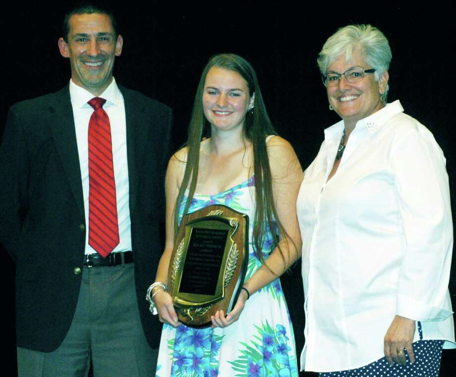 Kelsey Johnson poses with Spartan athletic director Matt Perachi and Shepaug principal Kim Gallo after being presented during Shepaug Valley School's annual sports awards ceremony with the prestigious Ray Marinko Award as the Berkshire League's top athlete for 2014-15 on June 5. Photo: Norm Cummings / Norm Cummings / The News-Times