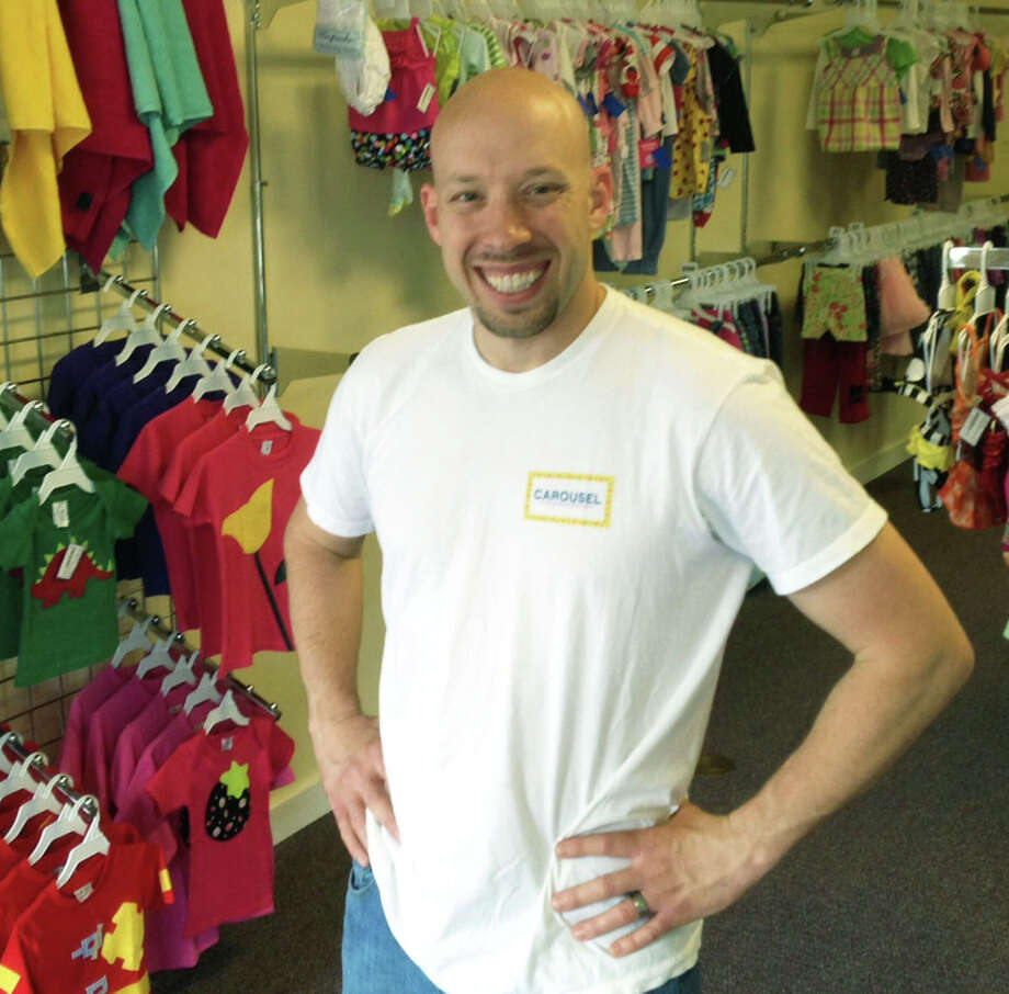 Co-owner Chris Kopp offers a welcoming smile to patrons of Carousel Kidsignment Boutique, located at 146 Danbury Road (Route 7 South) in New Milford. June 2015 Photo: Norm Cummings / Norm Cummings / The News-Times