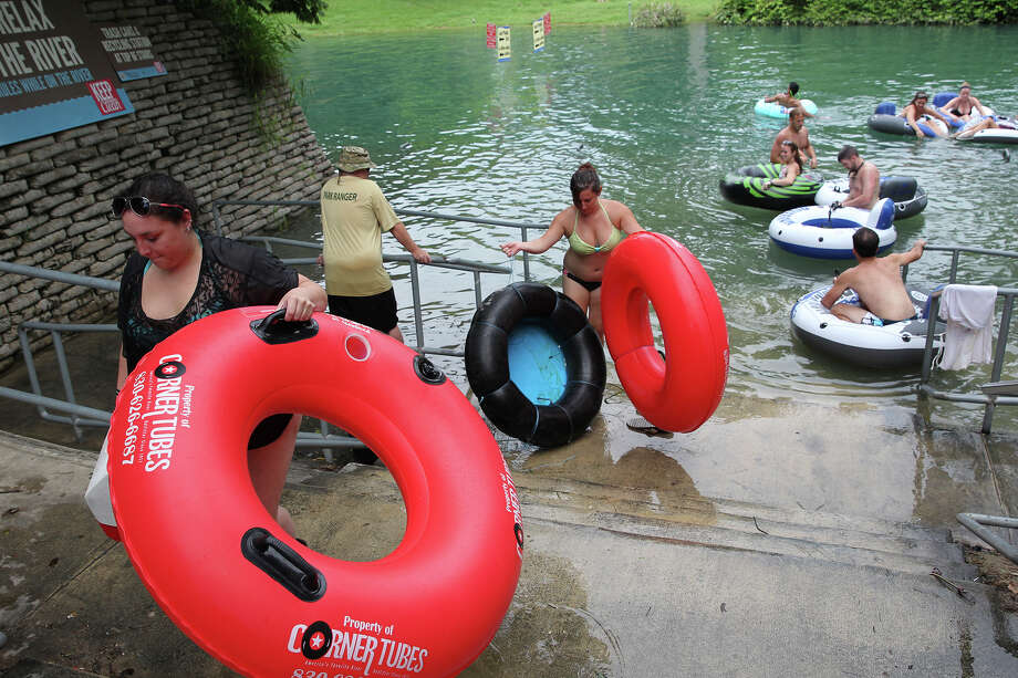 Tubers exit the Comal River at the last take out point. A tuber traffic jam on June 13 was cited during the debate on installing cameras there. Photo: Tom Reel /San Antonio Express-News