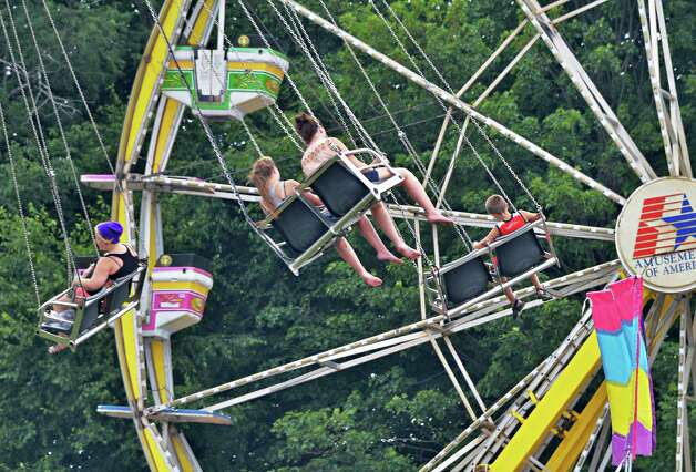 Fair goers keep cool on midway rides at the Saratoga County Fair in Ballston Spa, NY Tuesday July 16, 2013. (John Carl D'Annibale / Times Union) Photo: John Carl D'Annibale / 00023171A