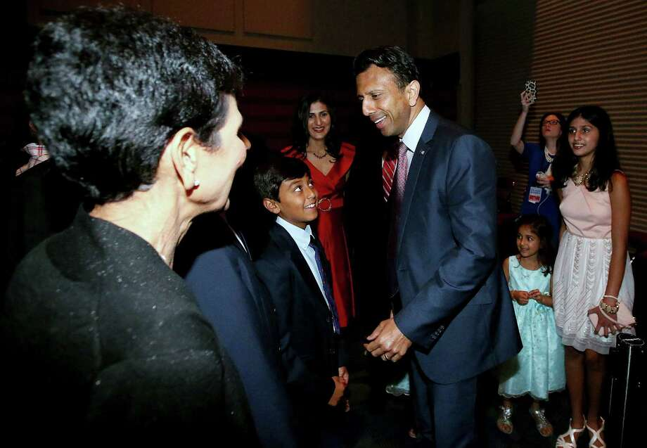 KENNER, LA - JUNE 24:  Louisiana Gov. Bobby Jindal (4th R)  visits with family prior to announcing his candidacy for the 2016 presidential nomination during a rally at the Pontchartrain Center on June 24, 2015 in Kenner, Louisiana. Jindal enters an already crowded filed for the Republican nomination for president.   (Photo by Sean Gardner/Getty Images) Photo: Sean Gardner, Stringer / 2015 Getty Images