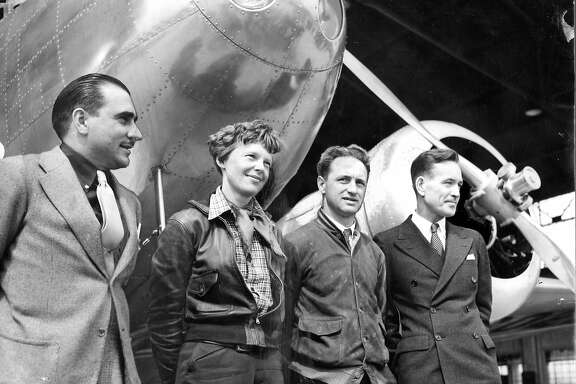Amelia Earhart in Oakland preparing for her around-the-world flight L to r Paul Mantz, Earhart, Harry Manning, Fred Noonan Likely staff photo negative files