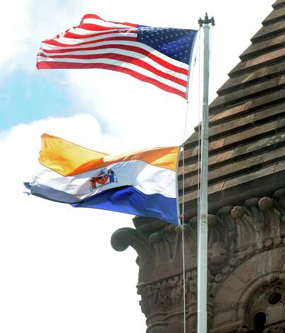 The City of Albany flag and the U.S. flag fly over City Hall on Wednesday, June 24, 2015, in Albany, N.Y. (Cindy Schultz / Times Union) Photo: Cindy Schultz / 00032378A