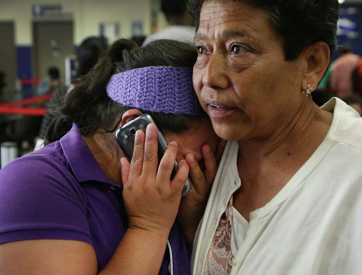 Olivia Olga Gonzalez, right, comforts Vilda Orosco, 30, who had just been released from Karnes County Residential Center with her son Jose Orosco, 11, after spending four months in detention, on Wednesday, June 24, 2015. Orosco was on the phone, at the San Antonio bus station, with a cousin in North Carolina letting them know she had been released and was on her way.