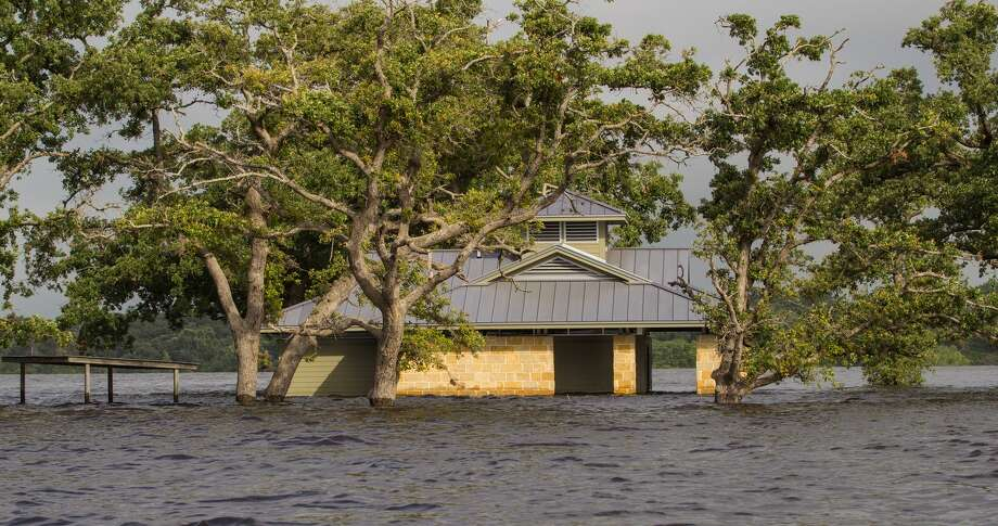 A building on Lake Somerville State Park's Birch Creek Unit sits in floodwaters from record May and June rains. Flooding has more than two dozen state parks wholly or partially closed as summer begins.