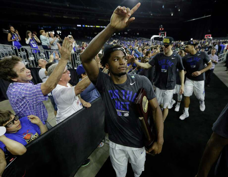 Justise Winslow, center, starred locally at St. John's School before helping lead Duke to a national title this past season, raising his profile ahead of the NBA draft.  Photo: Brett Coomer, Houston Chronicle / © 2015 Houston Chronicle