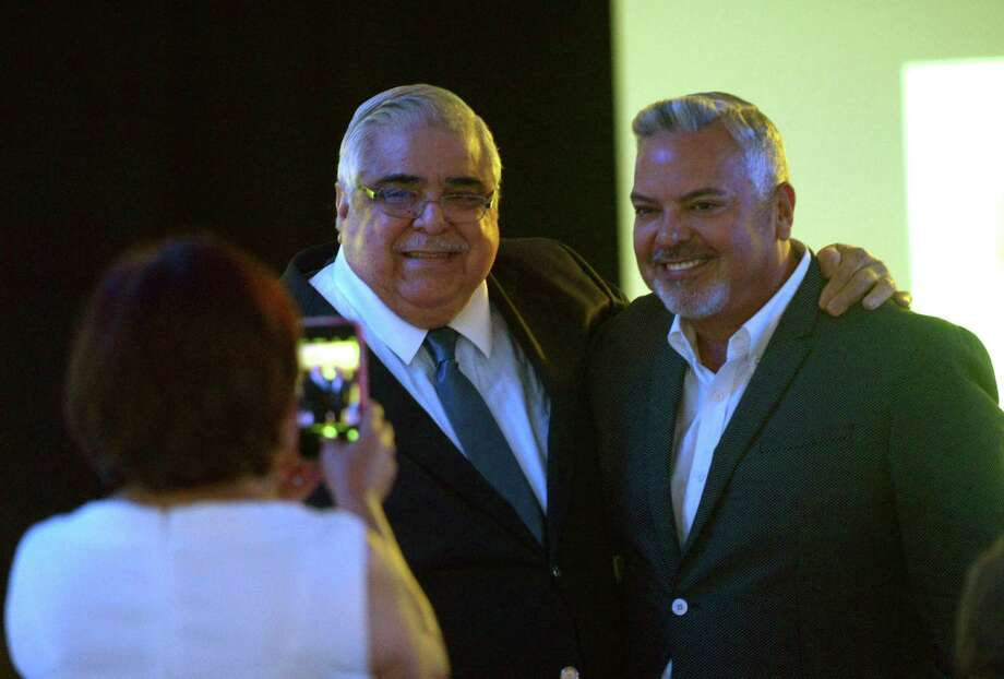 Paul Elizondo poses with Democratic National Committee treasurer and friend Henry Muñoz III during Elizondo's party. Photo: Billy Calzada /