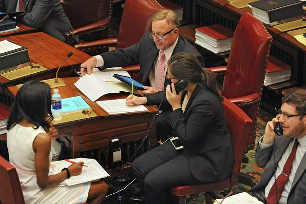 Senator John DeFrancisco reads through bills during session in the Senate chamber at the New York State Capitol on Wednesday, June 24, 2015 in Albany, N.Y. (Lori Van Buren / Times Union) Photo: Lori Van Buren / 00032380A