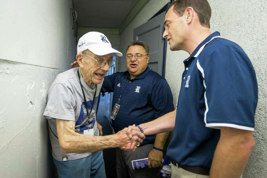 "New Rice athletic director Joe Karlgaard, right, is introduced to legendary Owls All-American James ""Froggy"" Williams, left, by Senior Executive Athletic Director Rick Mello before a college football game against Kanas at Rice Stadium, Saturday, Sept. 14, 2013, in Houston. Williams played as an end and kicker at Rice from 1946 to 1949 and became a member of the College Football Hall of Fame in 1965.  ( Smiley N. Pool / Houston Chronicle ) Photo: Smiley N. Pool, Staff / © 2013  Houston Chronicle"
