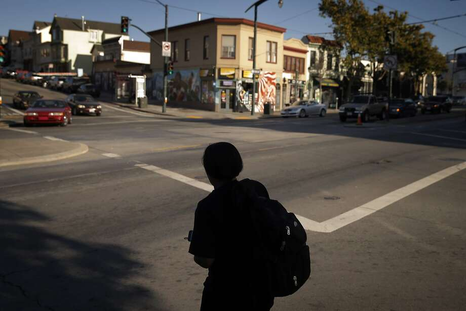 A pedestrian waits to cross 3rd Street on Palou Avene in the Bayview Neighborhood of San Francisco, Calif., on Wednesday, June 24, 2015. A new Stanford study shows that black middle class families are much less likely to live in a good neighborhood than their white peers of the exact same income. The researchers calculated average median incomes for neighborhoods and found that blacks and Hispanics at all rungs of the economic ladder came out substantially worse than their white and Asian peers. Photo: Carlos Avila Gonzalez, The Chronicle