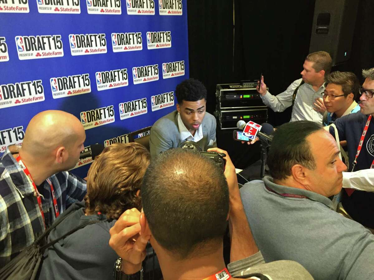 Sam Blum / Times Union D?Angelo Russell talks to the media Wednesday ahead of Thursday?s NBA draft. He addressed a report that suggested he was reluctant to be selected by the Philadelphia 76ers. The first round of the draft gets under way at 7 p.m. at Barclays Center.