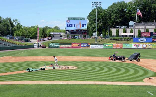 Grounds crew members work to ready Joe Bruno Stadium for tomorrow's home opener Wednesday June 24, 2015 in Troy, NY.    (John Carl D'Annibale / Times Union) Photo: John Carl D'Annibale