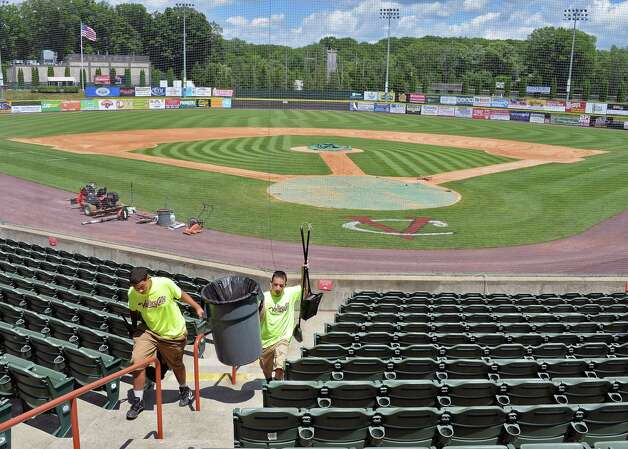 Maintenance crew members Jerell Dukes, left, and Dylan Carbonaro ready Joe Bruno Stadium for tomorrow's home opener Wednesday June 24, 2015 in Troy, NY.    (John Carl D'Annibale / Times Union) Photo: John Carl D'Annibale