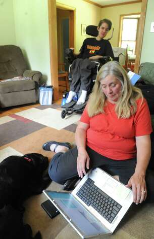 Gwen Klapp is working to raise funds to purchase a robotic arm for her son Jordan Klapp on Friday June 19, 2015 in Greenfield Center, N.Y. Jordan, a senior at Saratoga Springs High School, who is graduating in June,was diagnosed with Duchenne Muscular Dystrophy (DMD), a muscle wasting disease for which there is no current treatment or cure. He lost his oldest brother to DMD. His family is raising more than $50,000 to get him a robotic arm. (Michael P. Farrell/Times Union) Photo: Michael P. Farrell / 00032322A