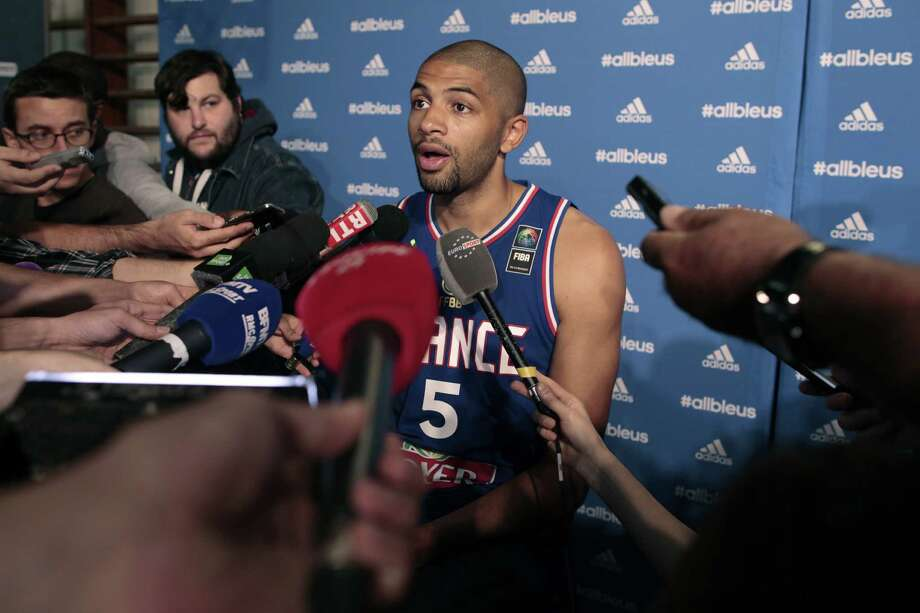 French basketball player Nicolas Batum talks to journalists during an event to mark 100 days to go until the EuroBasket championships on May 27, 2015 in Paris. AFP PHOTO / CHARLY TRIBALLEAUCHARLY TRIBALLEAU/AFP/Getty Images Photo: CHARLY TRIBALLEAU, Stringer / AFP
