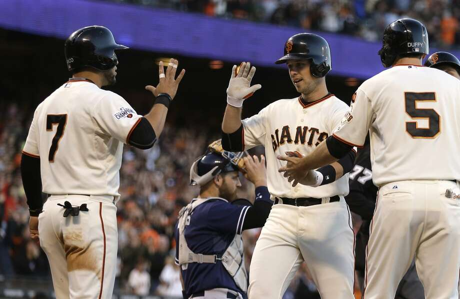 San Francisco Giants' Buster Posey, second from left, is congratulated by Gregor Blanco (7), and Matt Duffy (5) after Posey hit a grand slam off San Diego Padres' Ian Kennedy in the third inning of a baseball game Wednesday, June 24, 2015, in San Francisco. (AP Photo/Ben Margot) Photo: Ben Margot, Associated Press