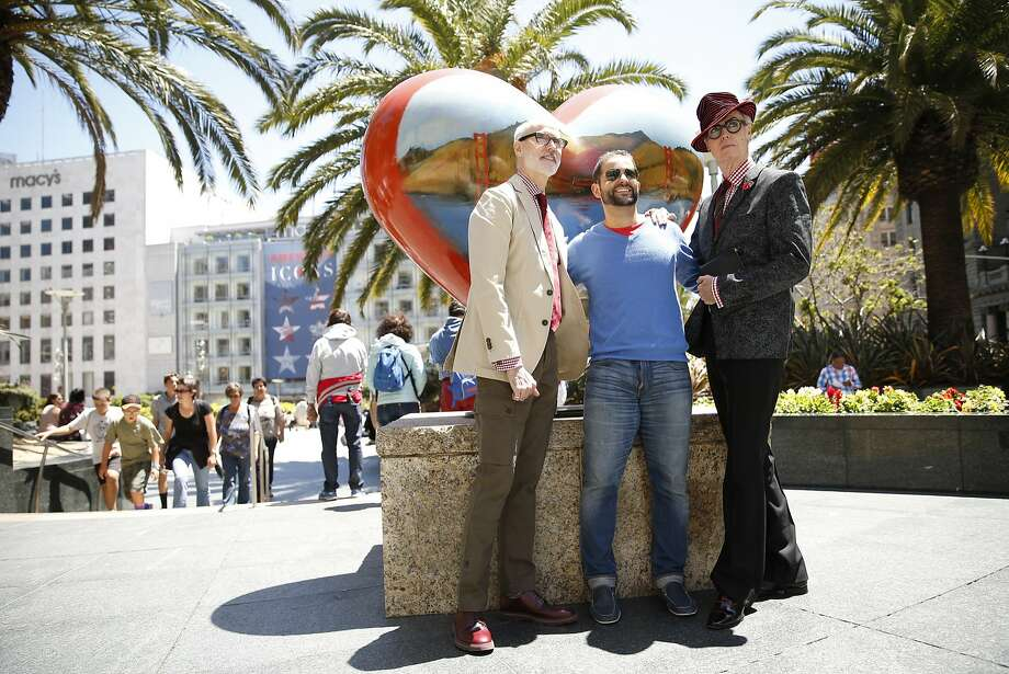 New York City's iconic fashion figure Patrick McDonald (right) and his brother Michael McDonald (left) pose with Spanish tourist Victor Fernandez in Union Square in San Francisco on Wednesday, June 24, 2015. Photo: Scott Strazzante, The Chronicle