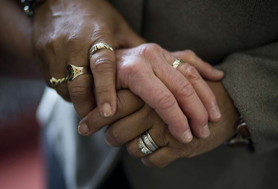 Diane Sabin and Jewelle Gomez show their wedding rings at their home on June 24, 2015 in San Francisco, Calif. Sabin and Gomez were married in 2008 after being plaintiffs in the original lawsuit when gay marriages were ruled invalid. Photo: Erin Brethauer, The Chronicle