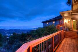 A redwood view deck beside the entryway overlooks the Bay Area.