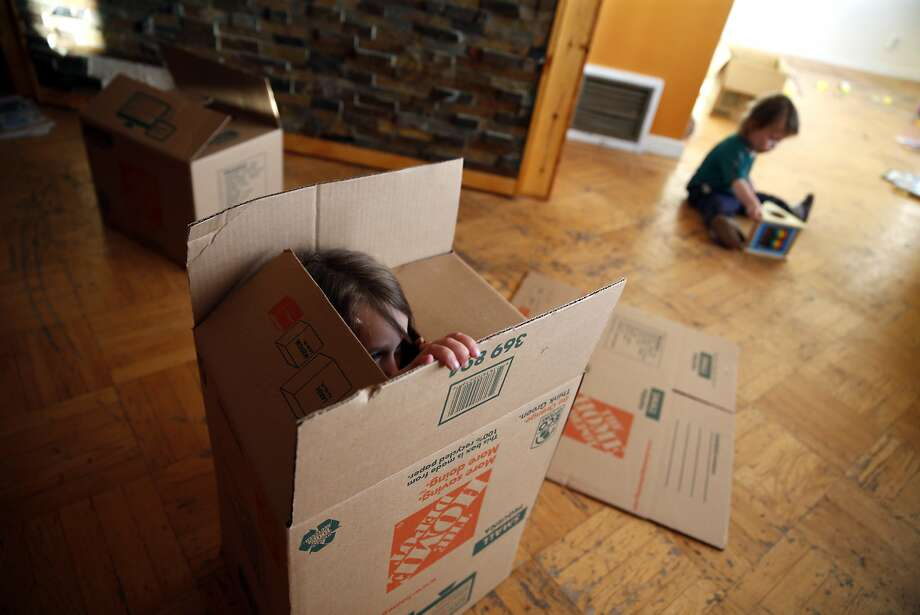 Saoirse Dwyer, 5, plays in a box as her brother, Cianan, 18 months, plays nearby as the Dwyer family prepares to move out of their residence in San Francisco, Calif., on Wednesday, June 24, 2015. Photo: Scott Strazzante, The Chronicle