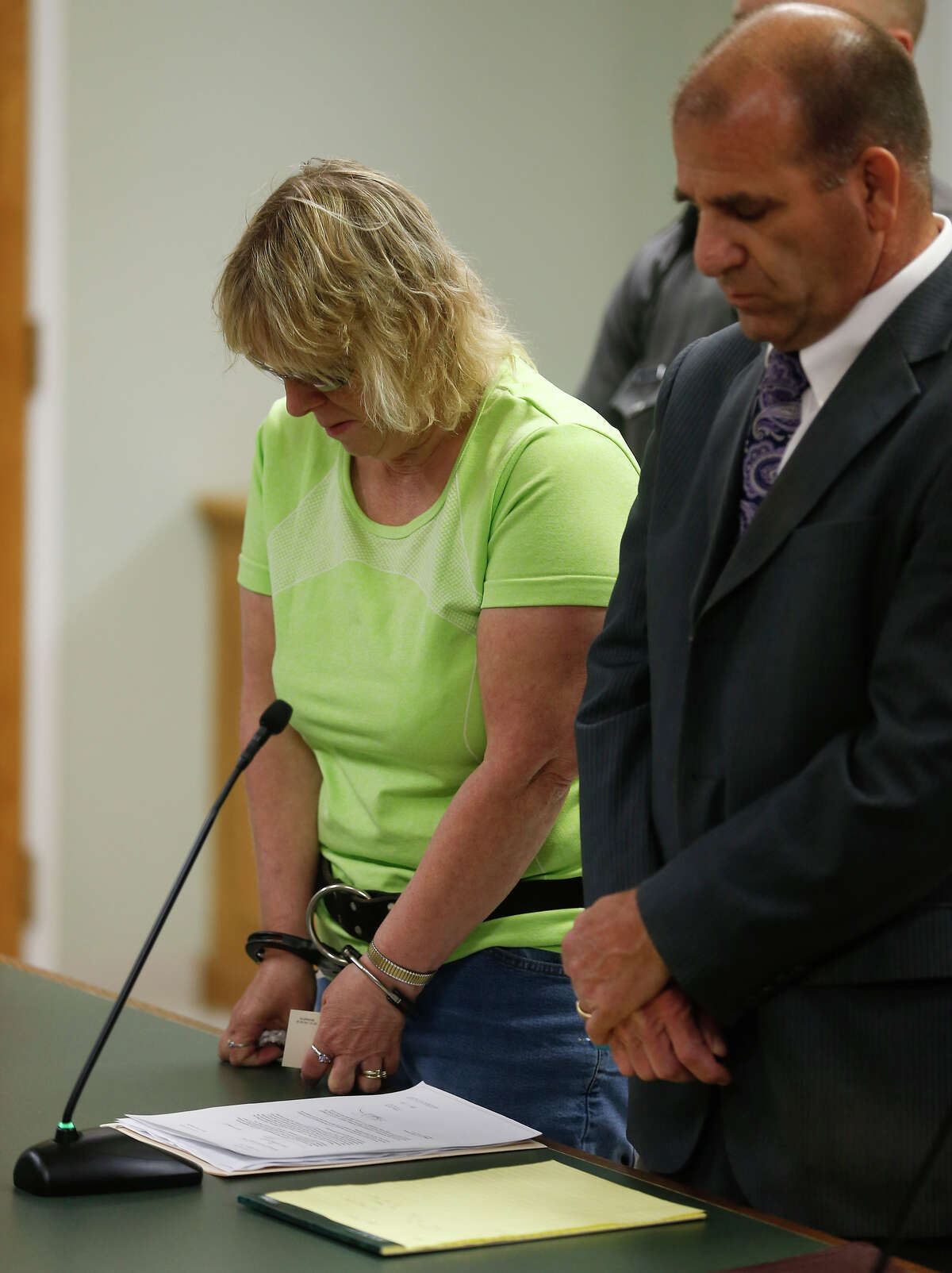 FILE - Joyce Mitchell stands with her attorney Keith Bruno during her arraignment in City Court June 12, 2015 in Plattsburgh, New York. Mitchell was arrested Friday for allegedly helping two convicted murderers, David Sweat and Richard Matt, escape the maximum security section of the Clinton Correctional Facility in Dannemora.