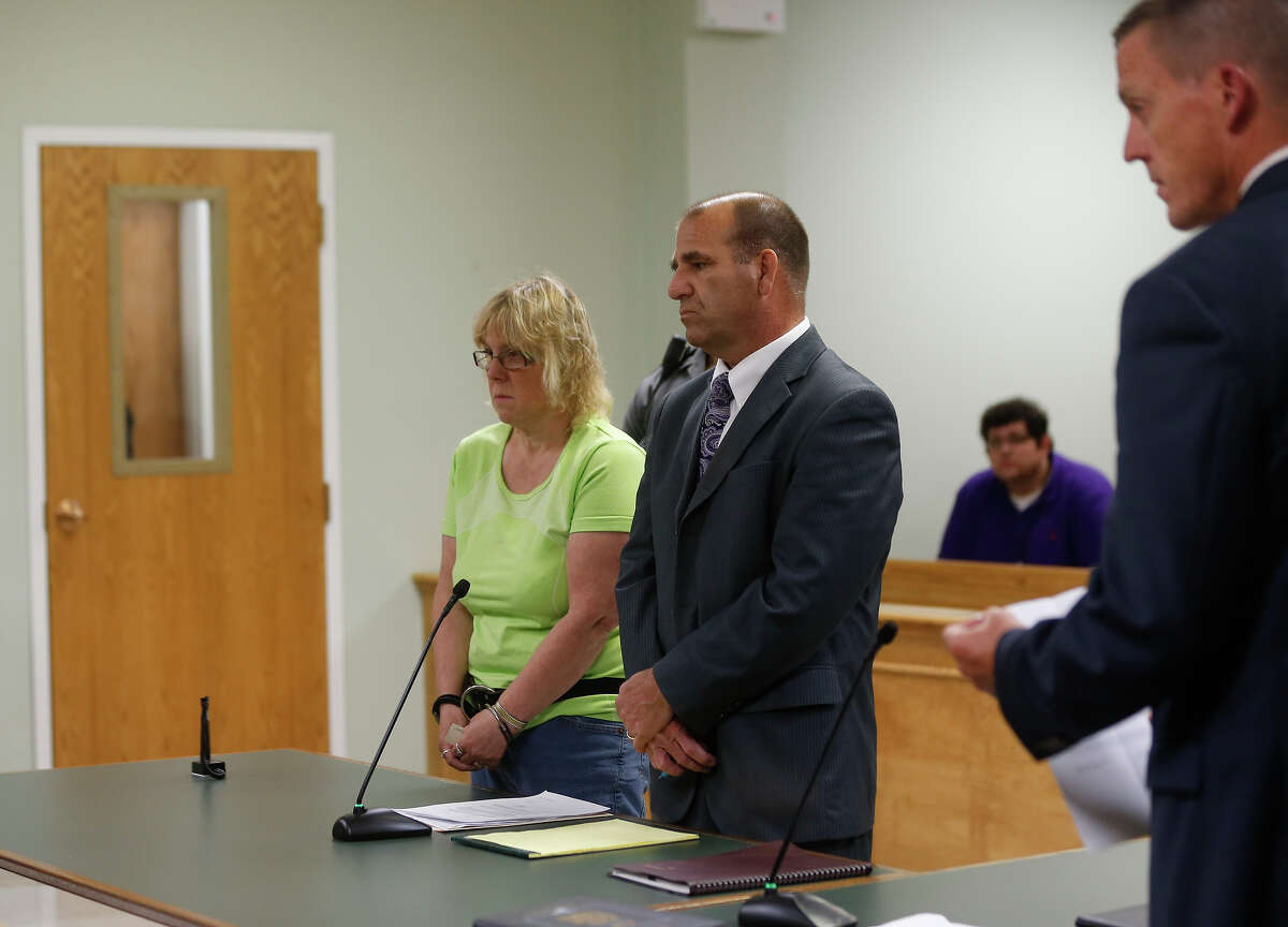 FILE -Joyce Mitchell stands with her attorney Keith Bruno during her arraignment in City Court June 12, 2015 in Plattsburgh, New York. Mitchell was arrested Friday for allegedly helping two convicted murderers, David Sweat and Richard Matt, escape the maximum security section of the Clinton Correctional Facility in Dannemora.