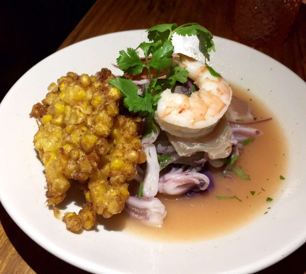 The Peruvian ceviche has the traditional corn, but encased in a crisp batter ($14).