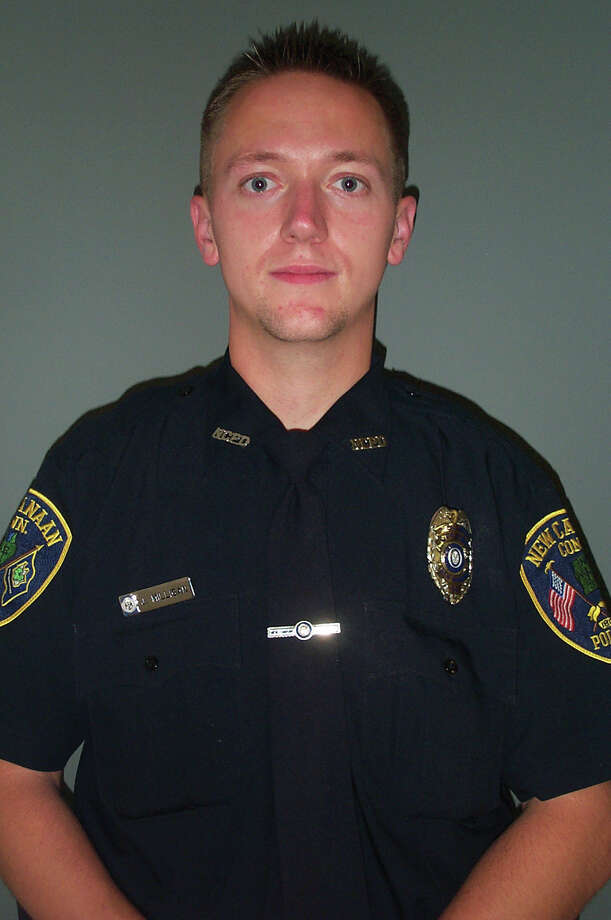 New Canaan Police Sgt. John Milligan, seen in this file photo from 2012, will keep his job after an unpaid suspension Photo: Contributed Photo / ST / New Canaan News