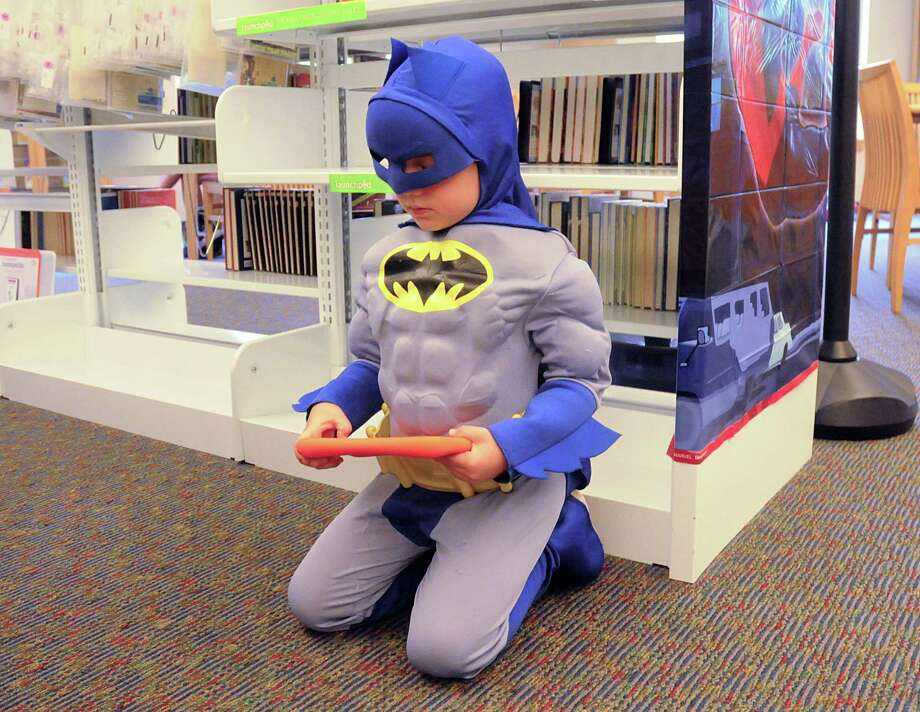 Batman, aka five year old Sebastian Durisek, uses one of the new Launchpads, which are educational tablets/e-readers for kids, at the Mitchell Library, 8125 Ashlane Way in The Woodlands, Children's Library. The computers have educational games that children can play. Photograph by David Hopper. Photo: David Hopper, Freelance / freelance