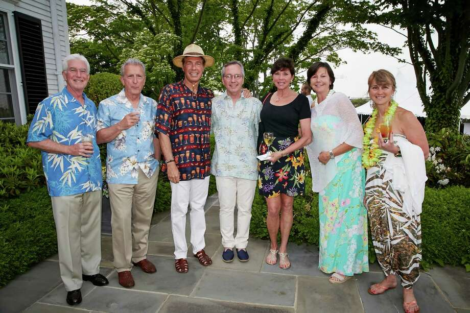 """John Straus (New Canaan), Rocco D'Angelo (Darien), Dave Tortorello, Family Centers' President Bob Arnold, Mary Ellen Tortorello, Diane Straus (New Canaan) and Netta D'Angelo (Darien) attend Family Centers' recent """"South Pacific"""" fundraiser in Greenwich. Photo: Contributed Photo / New Canaan News"""