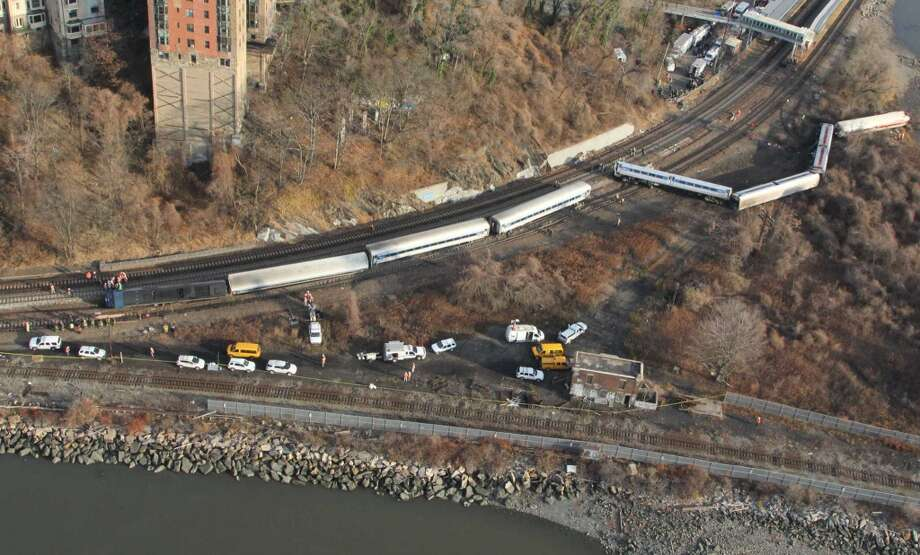 NEW YORK, NY - DECEMBER 01:  In this handout photo provided by the National Transportation Safety Board (NTSB),  a Metro North train sits derailed December 01, 2013 in the Bronx borough of New York City. Multiple injuries and four deaths were reported after the seven car train left the tracks as it was heading to Grand Central Terminal along the Hudson River line.  (Photo by NTSB via Getty Images) ORG XMIT: 453423805 Photo: Handout, Getty