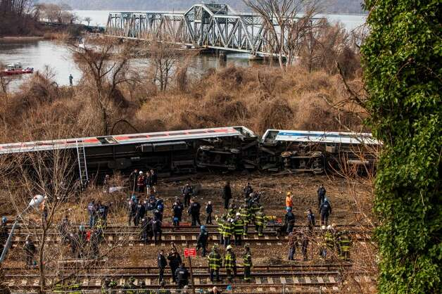 NEW YORK, NY - DECEMBER 1:  Emergency crews help injured passengers after Metro-North train derailed near the Spuyten Duyvil station December 1, 2013 in the Bronx borough of New York City. Multiple injuries and several deaths were reported after the seven car train left the tracks as it was heading to Grand Central Terminal along the Hudson River line.  (Photo by Christopher Gregory/Getty Imag